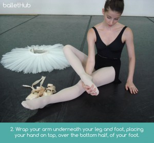 Foot stretching exercise for dancer on floor