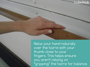 Place your hand on top of the ballet barre