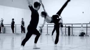 In the middle, somewhat elevated in rehearsal